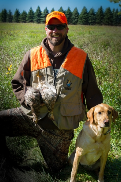 Bret with a pair of Minnesota prairie chickens