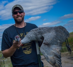 Bret with a sandhill crane from hunting with Cory Loeffler in NW Minnesota