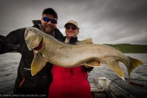 Bret and Trevor Montgomery from Tazin Lake Lodge with a lake trout