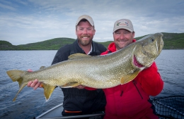 Bret with Trevor Montgomery from Tazin Lake with a giant lake trout