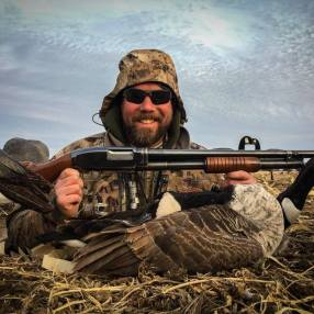 Bret with his grandpa's Model 12 and a goose in western Minnesota